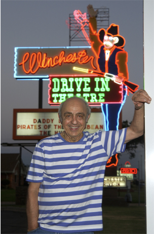 Owner and operator Lindy Shanbour in front of the Winchester Drive-In movie theater.  Staff Photo by Paul Hellstern
